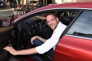 Director Patrick Brice enjoys the Aston Martin