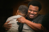 Craig Robinson and friend.